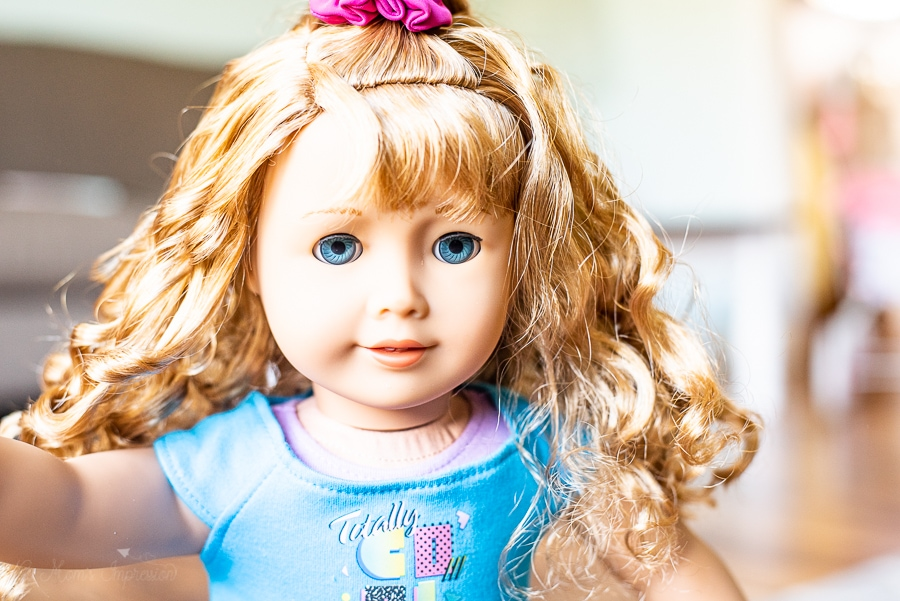 close up of a doll with ringlet hair from the 80s