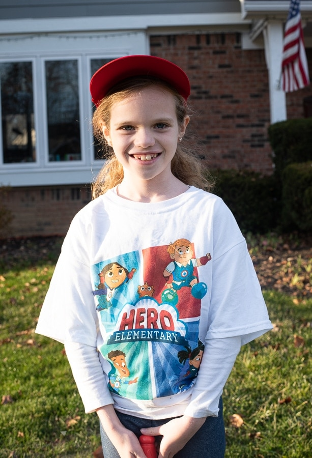 Girl wearing hero elementary shirt