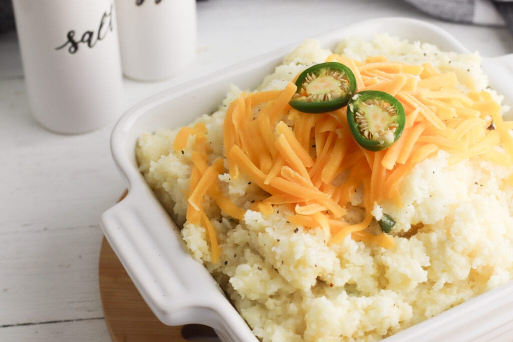 Jalapeno Cheese Grits Recipe being served in a bowl.