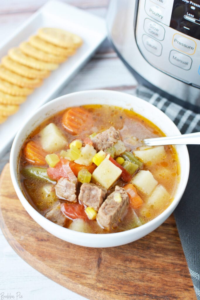 Pressure Cooker Vegetable Beef Soup being served for dinner.
