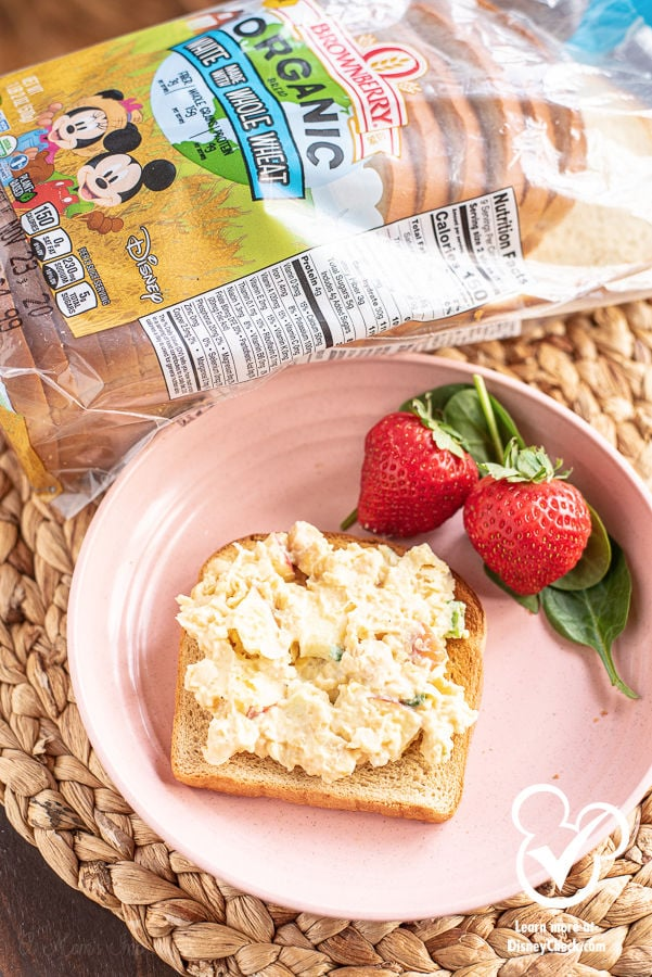 chickpea salad sandwich on a plate with strawberries