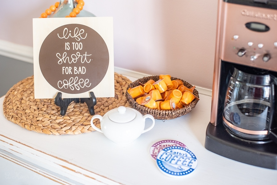 a coffee bar with some creamer and sugar and custom decor