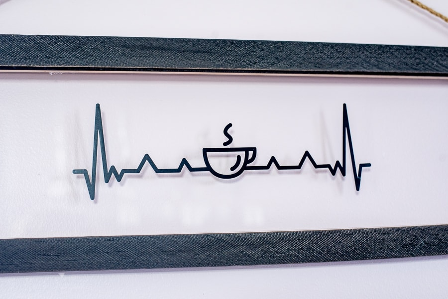 a heart beat sign with a coffee cup in the middle
