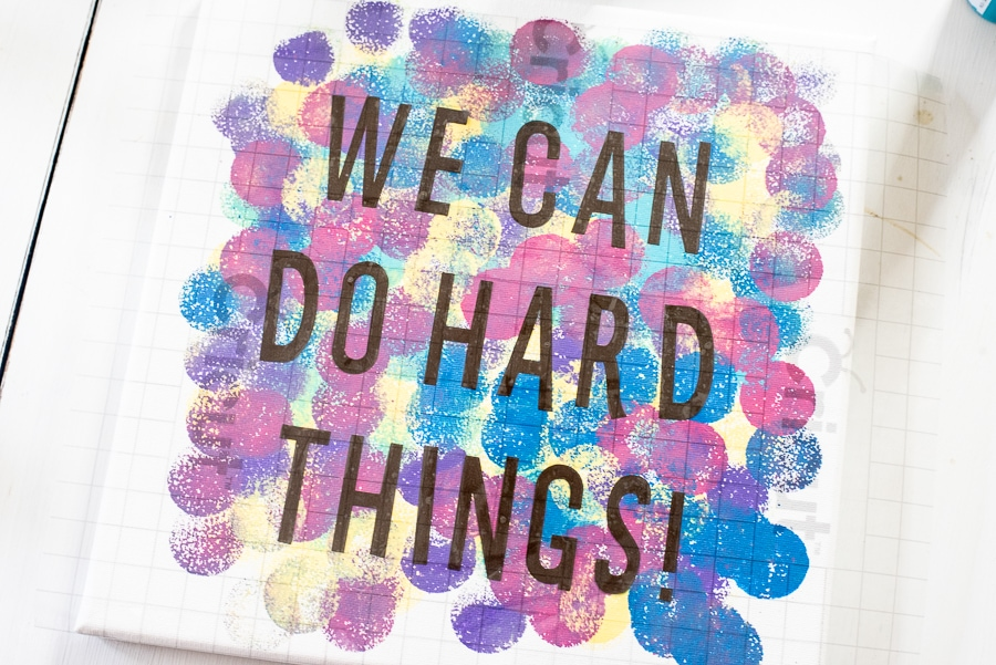 WE can do hard things quote written on a canvas