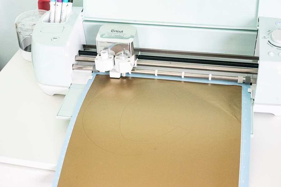 a cricut cutting machine cutting vinyl