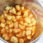 Add garlic powder, ginger, chicken broth and sauce