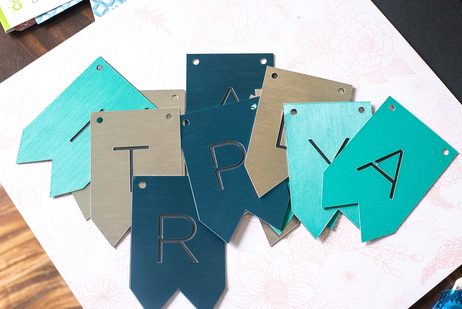 a bunch of blue and green letter flags on a table