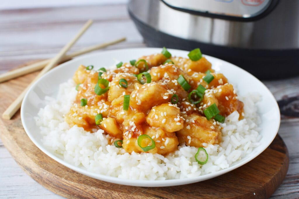 Instant Pot General Tso's Chicken being served over white rice.