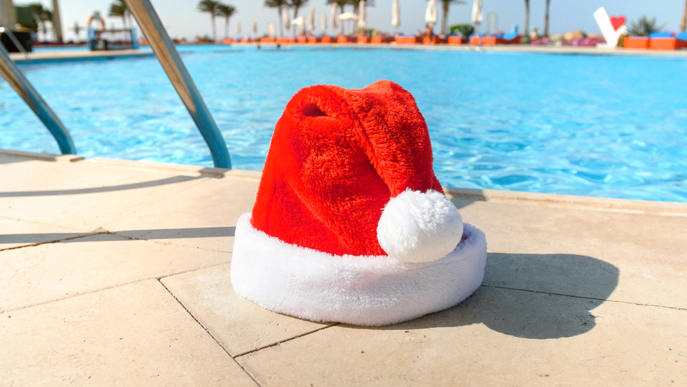 santa hat sitting by a swimming pool