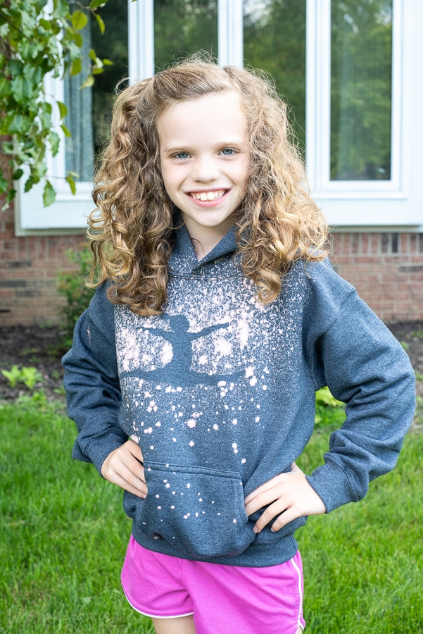 a girl wearing a gymnast hoodie