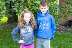 Two kids wearing custom hoodies with a bleached design on them