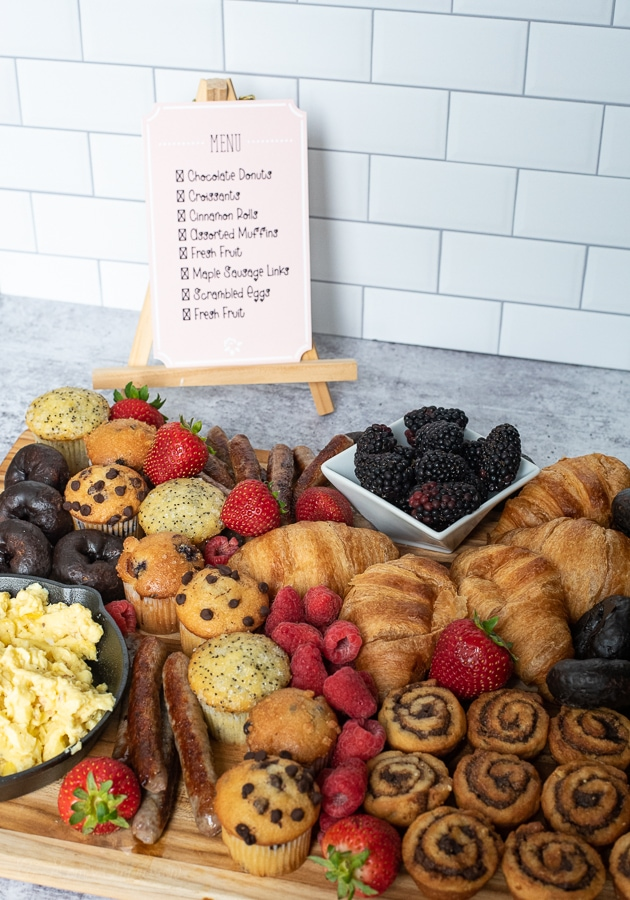 a spread of breakfast items with a menu in the background