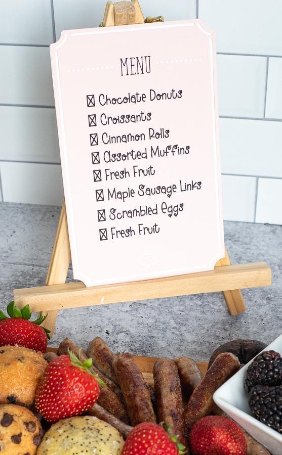 a breakfast menu on a wooden easel