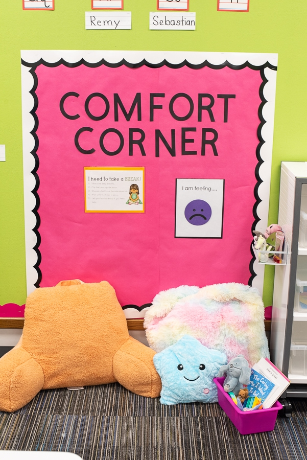 a comfort corner in a classroom with pillows and books